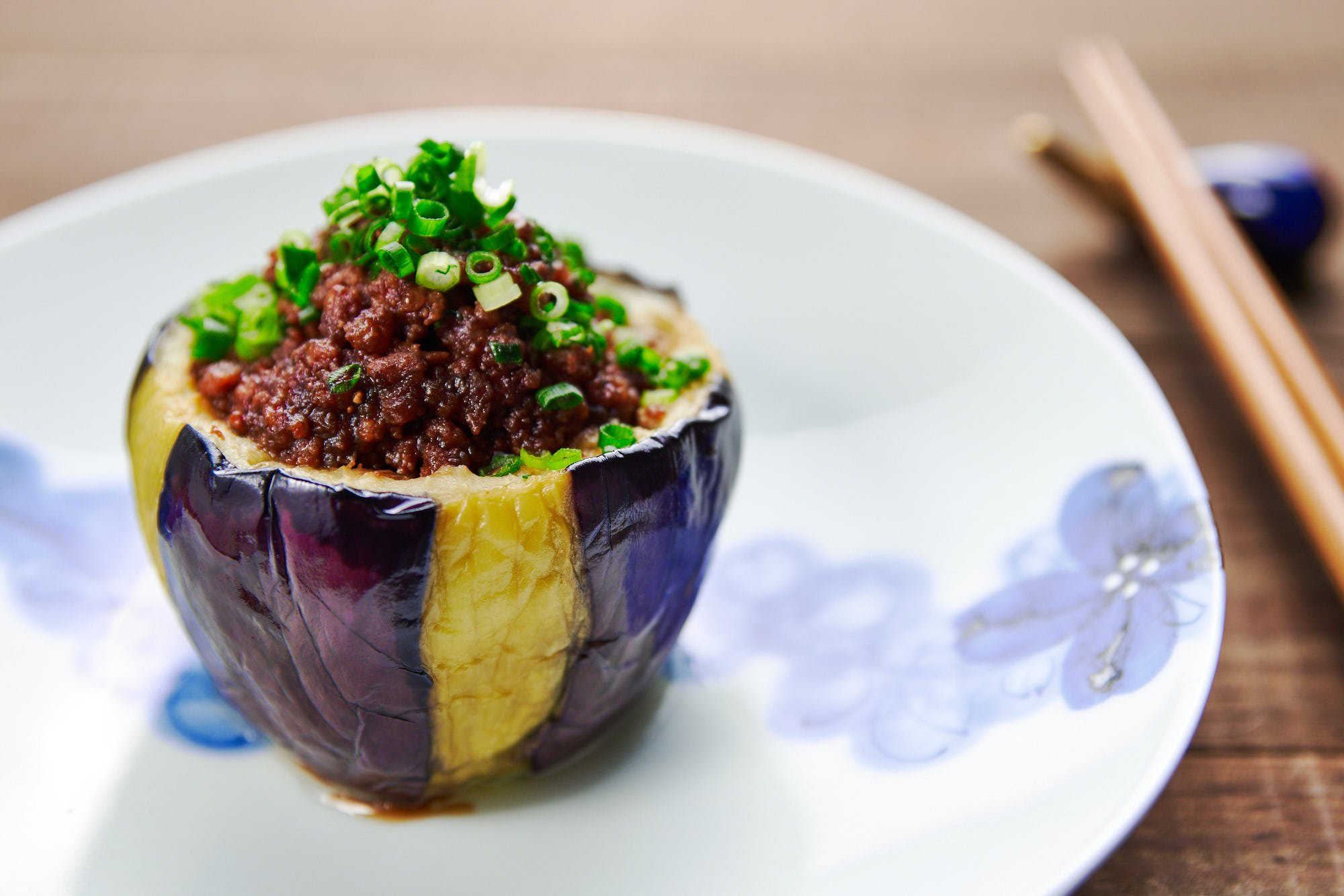 Caramelized miso and meat get stuff into a tender, creamy eggplant cup to make this Japanese Nasu Dengaku.