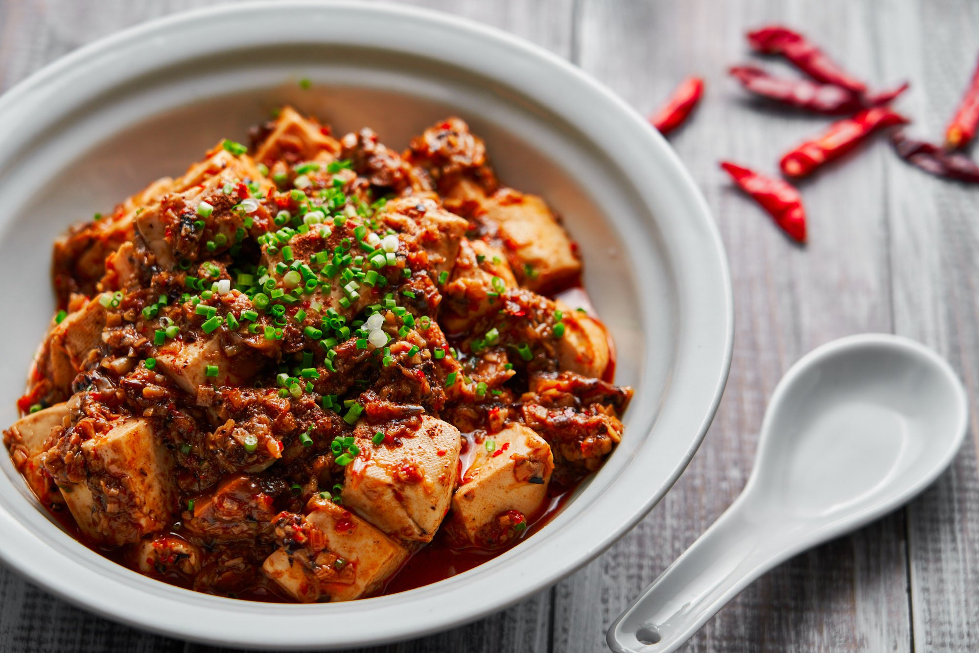 "With loads of aromatics and mushroom ground ""meat"" in the red hot sauce, this vegan Mapo Tofu is brimming with savory umami."