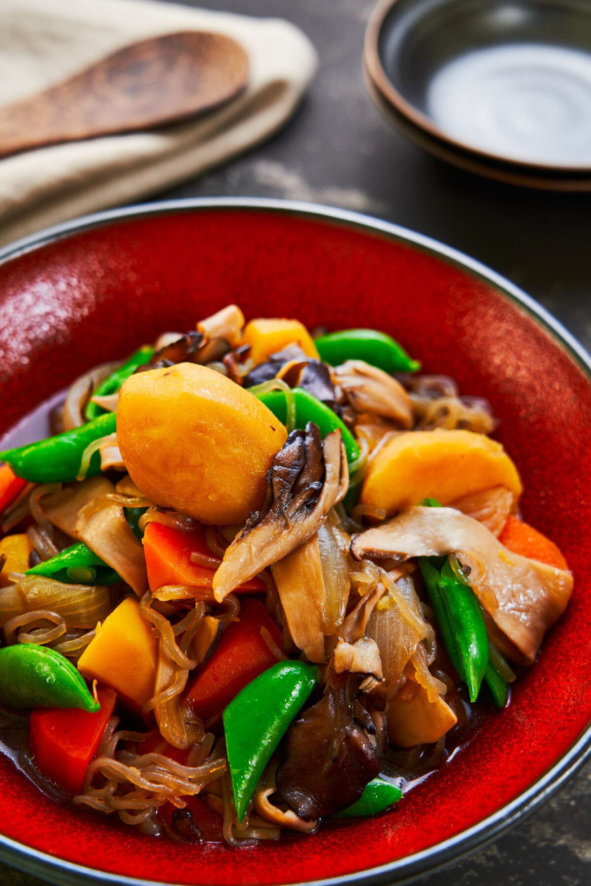 With big hearty chunks of potatoes and carrots cooked together with a meaty medley of mushrooms, you won't miss the meat in this vegan Nikujaga.