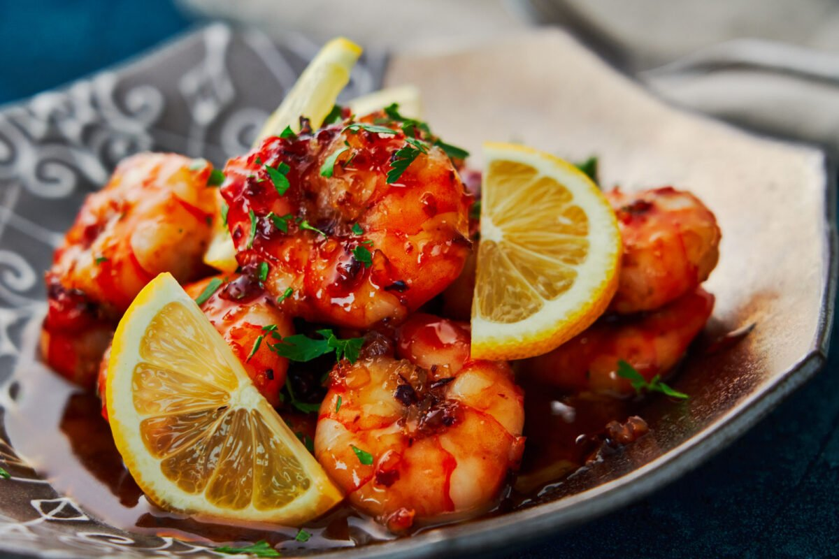 Caramelized honey and pungent garlic come together to make a sticky honey garlic glaze for this easy shrimp recipe.