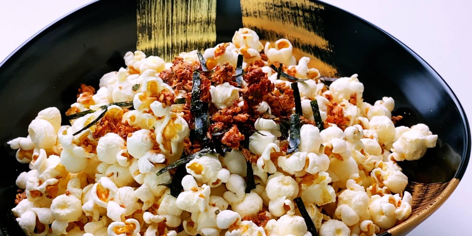 A bowl of popcorn sprinkled with Furikake seasoning.