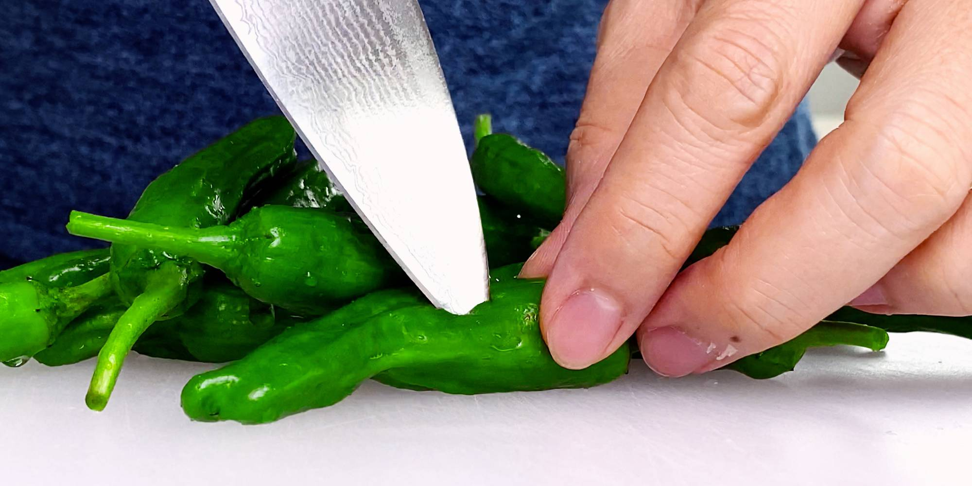 Poking holes in peppers to keep them from popping.