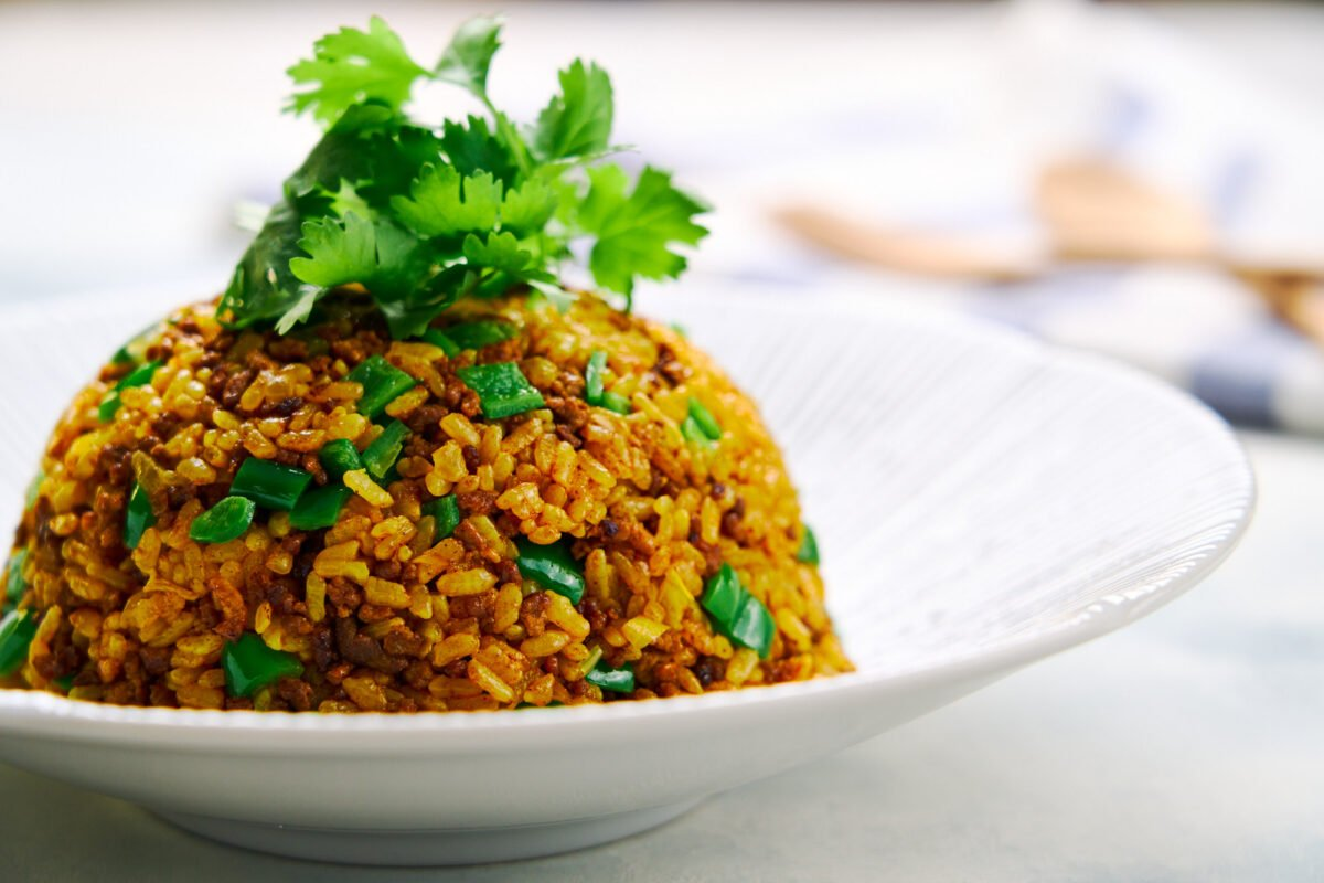 A mound of Japanese curry fried rice (Curry Chahan) topped with cilantro.