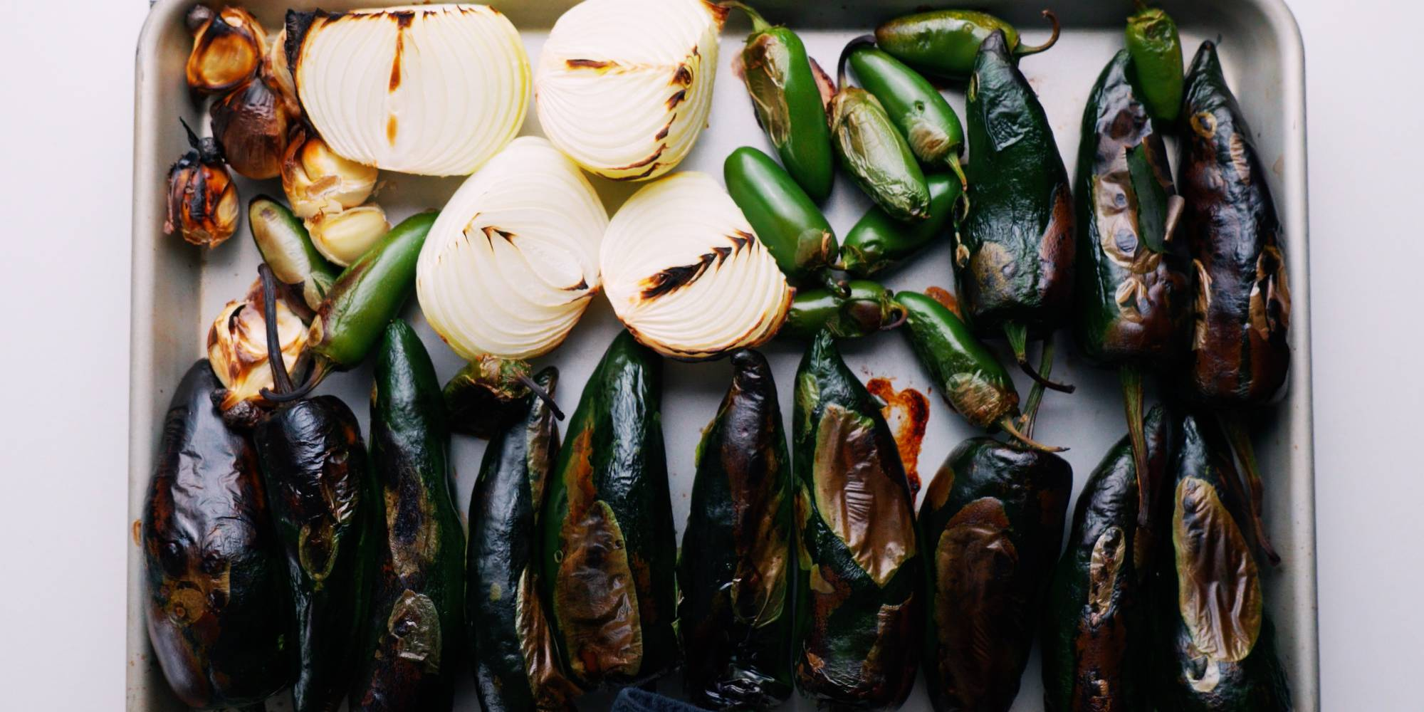 Char-roasted green chili peppers, onions, and garlic.
