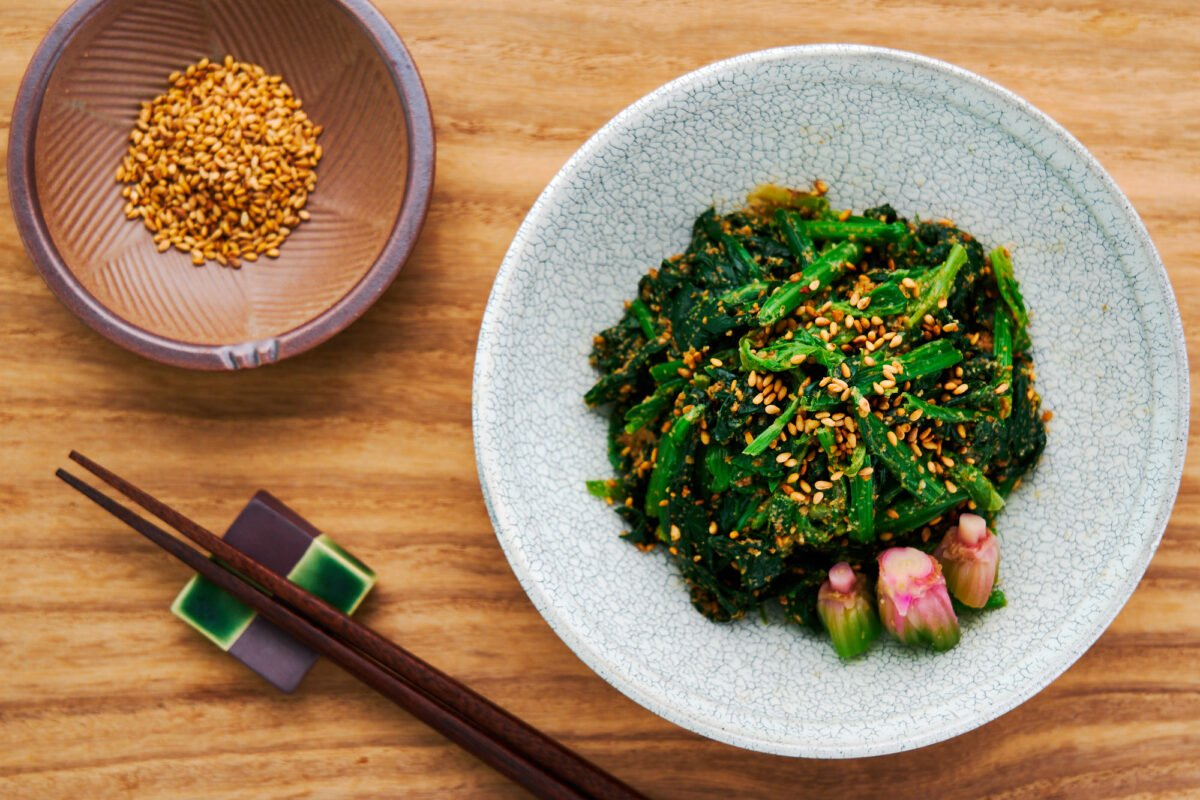 Sesame spinach (goma ae) is a traditional Japanese side dish made with just spinach, sesame seeds, soy sauce, and sugar.