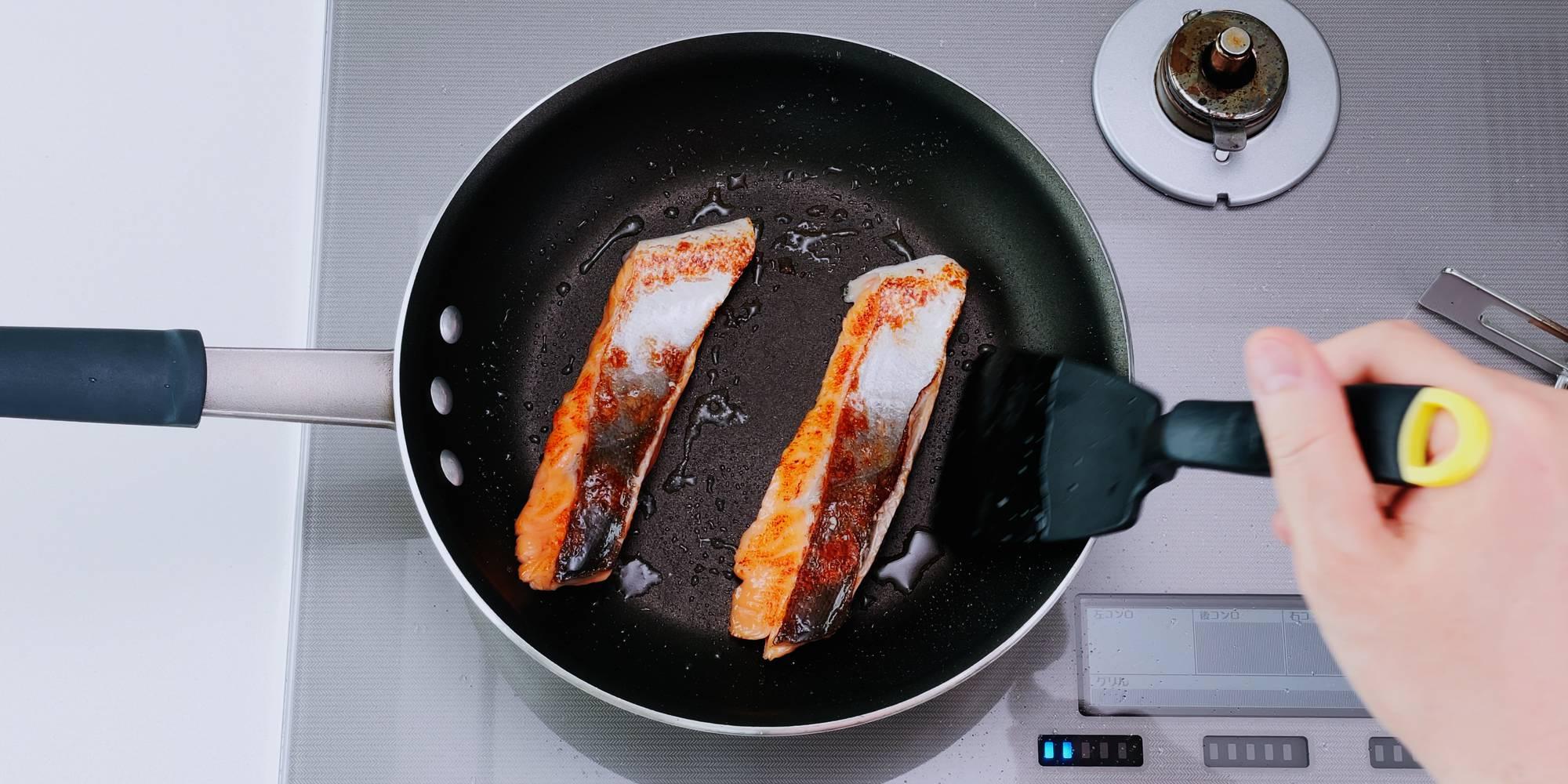 Japanese breakfast salmon in a frying pan.