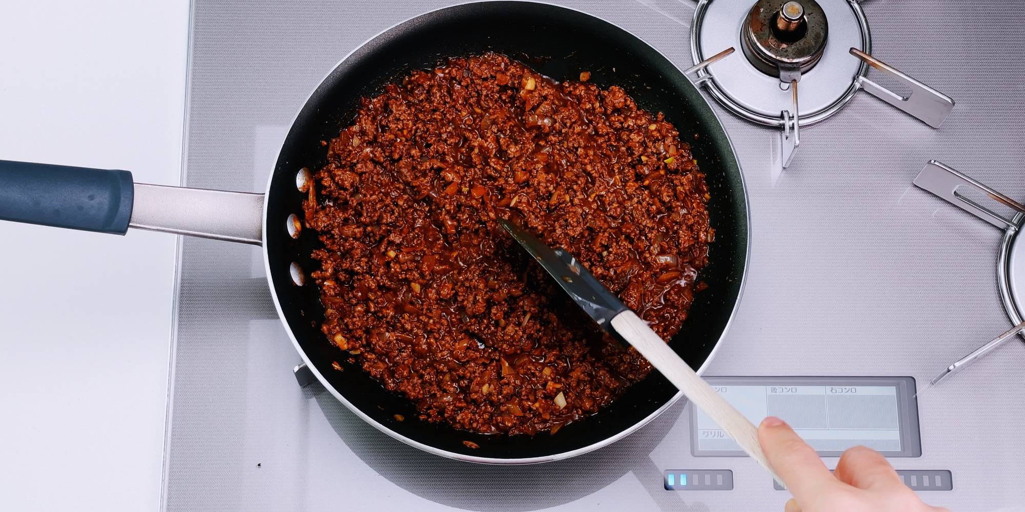 Taco meat for taco rice in a frying pan.