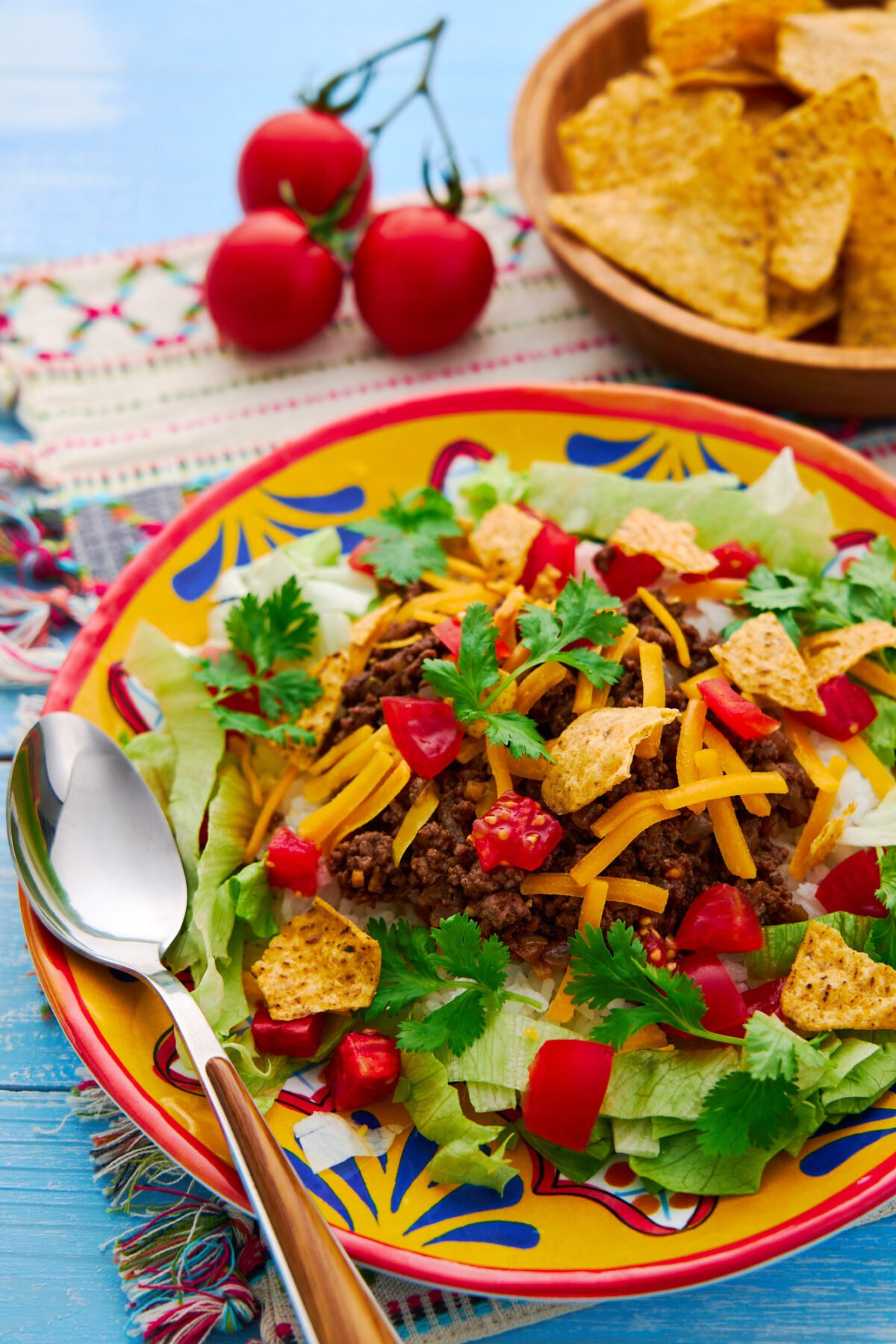 With vibrant layers of rice, taco meat, cheese, and veggies, taco rice, is an easy 1-plate meal that comes together in about 15 minutes.