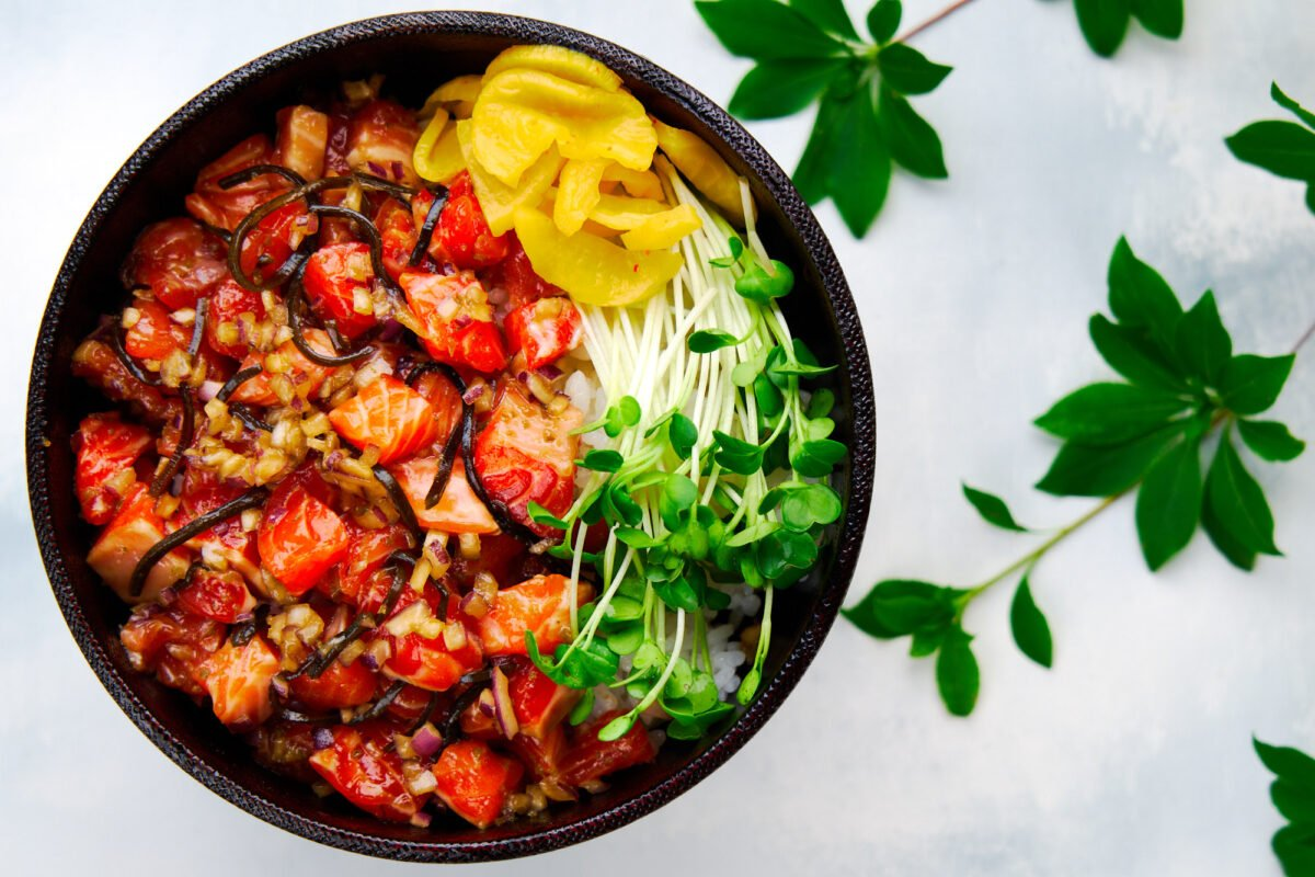 This spicy salmon rice bowl is loaded with umami and redolent of fresh yuzu with a spicy green chili kick.