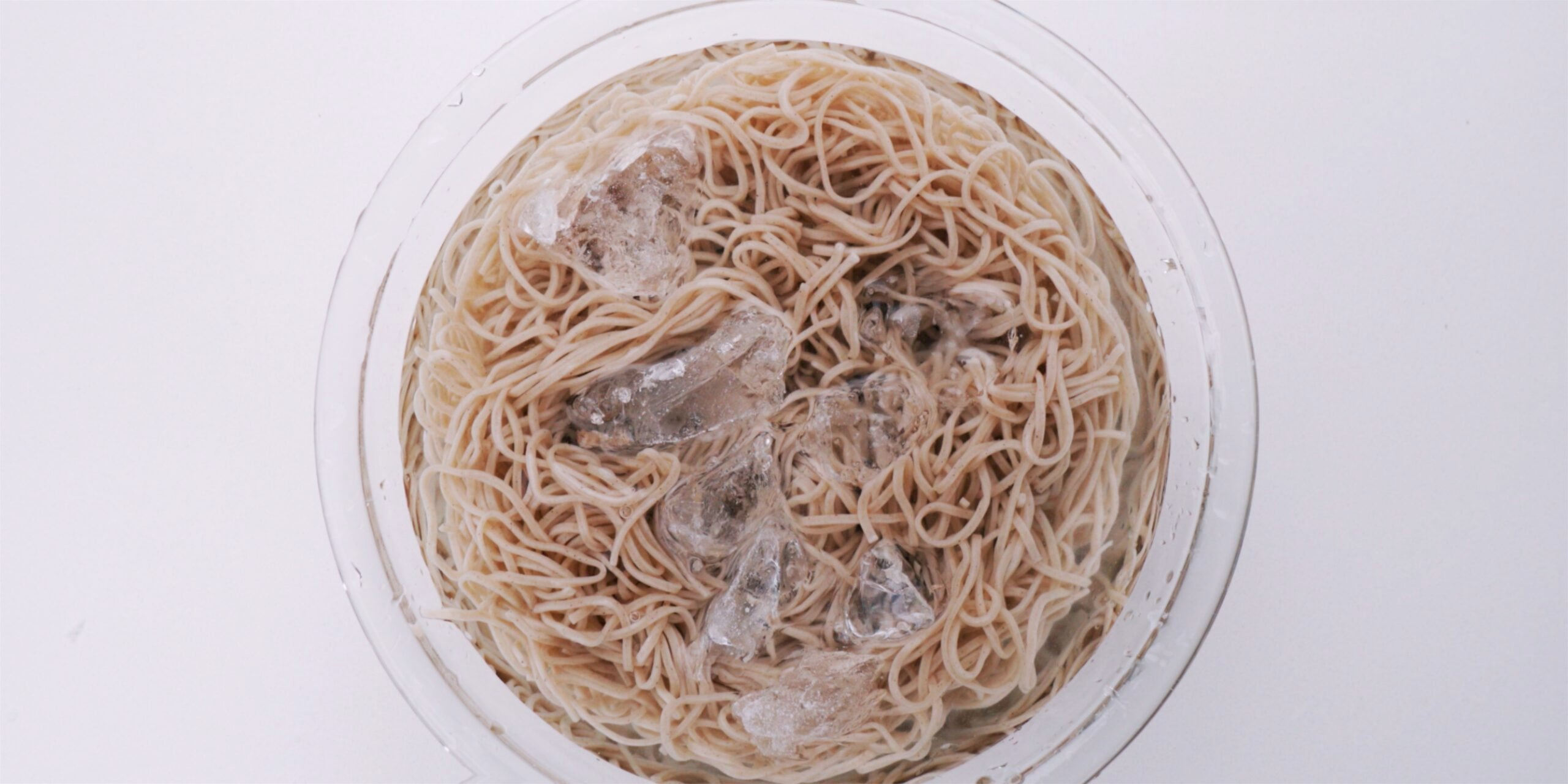 Chilling soba noodles in a bowl of ice water.