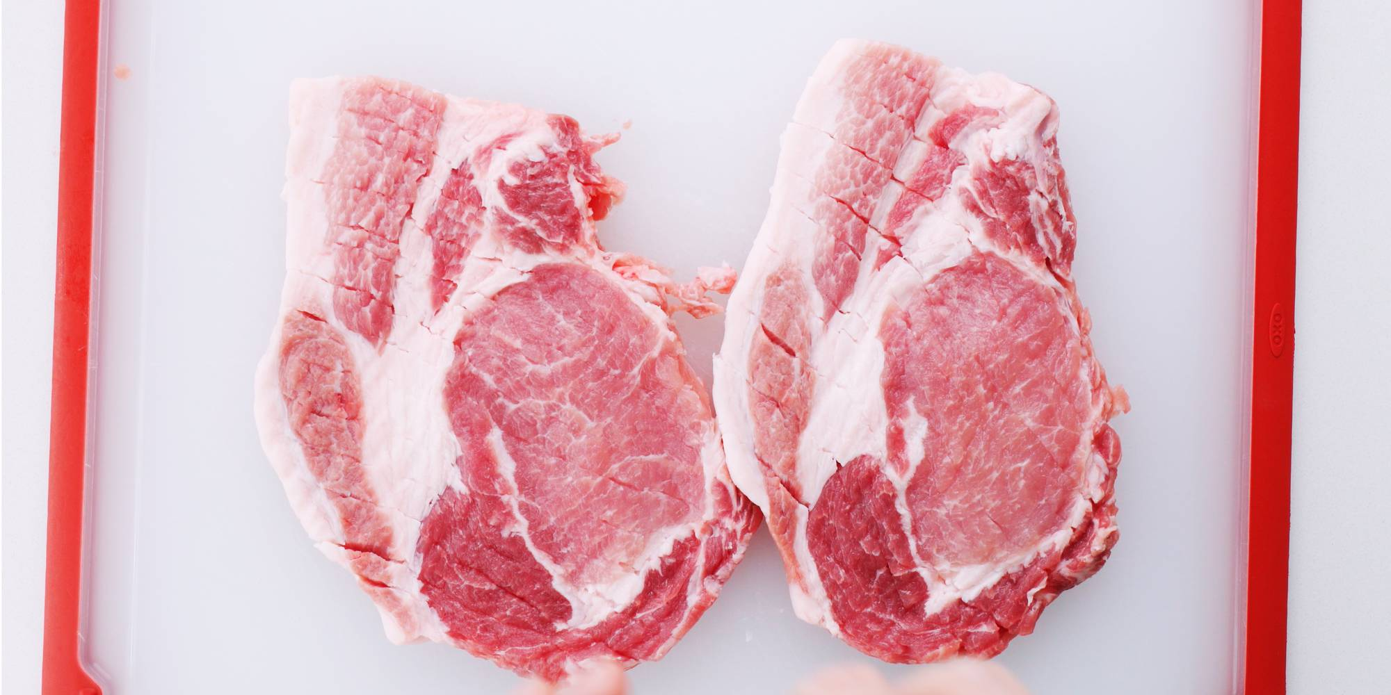 Pork chops pounded out with a mallet to tenderize and make thin cutlets.